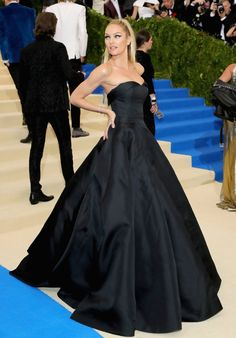 Candice Swanepoel Wearing a Topshop dress with Lorraine Schwartz jewels.