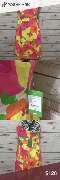 """Lily Pulitzer Betsey Dress Size 4 NWT Lilly Pulitzer Betsey dress in """"Hotty Pink Floral Punch"""" pattern. 100% Cotton jacquard fabric has woven floral dots for added dimension. Machine wash cold or dry clean. Dress is NWT but has small flaws. What appears to be ink dots in two places, the inside lining near neckline has small discoloration (possibly from makeup foundation when dress was tried on in store) & one dot has a small """"snag"""". The ink & makeup stains will likely go away in the wash…"""