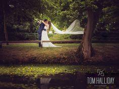 Pretty pond wedding photography - Tom Halliday Photography - vintage style wedding - UK wedding photography - rustic quirky vintage wedding - country wedding - landscape photography - veil photography - kiss photography
