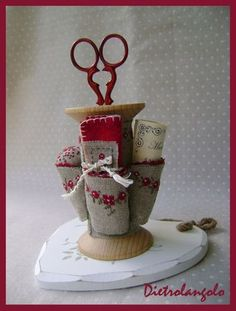 altered spool with places for goodies....cute