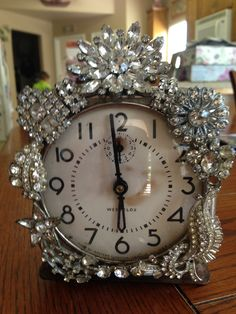 Vintage clock decorated with beautiful rhinestone jewelry.