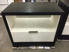 Our Corso Collection nightstand, C19-226, finished with a Black cerused exterior and Coconut interior case.