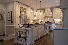 Platinum Kitchens: Beautiful island, wood hood