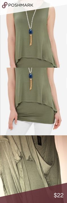 New hi low tunic from the Limited. Layered sleeveless tunic, stretch knit. 96% rayon, 4% spandex. New with tags. The Limited Tops
