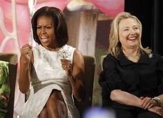 """At the 2012 International Women of Courage Awards ceremony, Michelle leads the crowd in a cheer of """"Happy Women's Day!"""""""