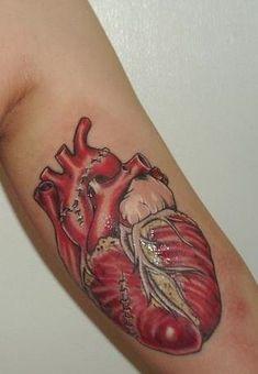 Repaired heart tattoo