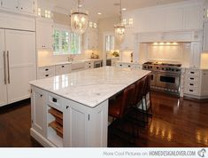 Notice the herringbone tiles by the range which looks pretty with the white woodworks around it.