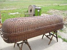 a wicker coffin. But more than that, it is a cooling coffin that was used to carry a body to the mortuary. Ice or cold water was placed in the pan below to help cool the body. The lid also aided in cooling.