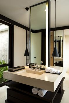 suspended lights, the two sided floating sinks and the cabinet design