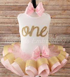 MY NEXT AVAILABLE DELIVERY DATE IS DECEMBER 6TH!! PLEASE DO NOT PLACE AN ORDER IF YOUR NEED BY DATE IS PRIOR TO DECEMBER 6TH    RUSH ORDERS ARE AVAILABLE, BUT YOU MUST CONTACT ME PRIOR TO PLACING A RUSH ORDER TO MAKE SURE I CAN ACCOMMODATE YOUR NEED BY DATE!!    CELEBRATE YOUR LITTLE ONES BIRTHDAY IN AN ADORABLE GLITTER BIRTHDAY SET!    This listing is for (1) Personalized applique birthday top, ribbon trim tutu and hair bow    You can choose either a white tank top or short sleeve top  Long…