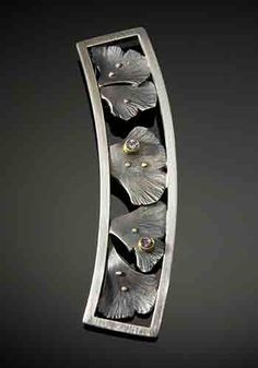 Gate ~ Jude Clarke ~ hammered, fabricated sterling silver with 14k and 22k gold and white sapphires