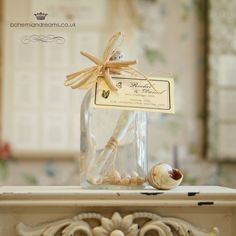 A popular wedding favour for beach or destination weddings, the message in a bottle is fun, quirky and inspiring! A love poem or a thank you message printed on a miniature scroll and lovingly put inside the bottle on a bed of natural shells. per item Wedding Invitations Online, Vintage Wedding Invitations, Wedding Stationery, Wedding Bottles, Wedding Favours, Message In A Bottle, Destination Weddings, Chic Wedding, Poem