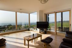 Internal view of bay window, and Rationel lift and slide doors.