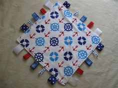 Nautical Ribbon Tag Baby Blanket - @Alyssa Taube, I could make her this if we could find the fabric!!
