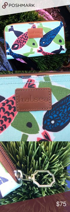"""Halsea Fish Frenzy Mint wallet NWOT Brand new, never used Halsea Fish Frenzy wallet in mint. Current retail is $88. Info from Halsea.com: This trim little number is designed to hold cards, bills and other essentials. The exterior is 100% Coated Cotton Canvas. The zipper extends around three of the four sides, and opens to reveal organizational pockets, and a zip pouch. A detachable leather strap can be added to make this wallet a wristlet.  Product Dimensions: 8"""" x 4.5"""" x 1"""" Halsea Bags…"""