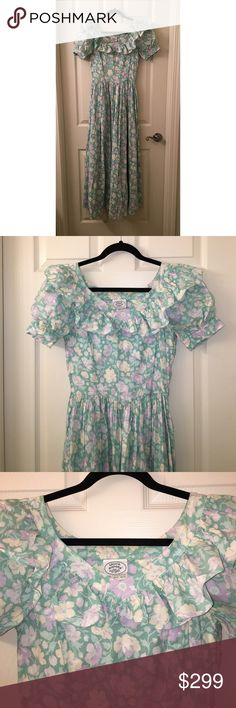 Vintage LAURA ASHLEY floral Prairie Dress US sz 10 Wow! This is a Vintage LAURA ASHLEY floral Prairie Dress in a US sz 10! Dress has along full skirt and measures about 50 in long! Bust measures about 30 in, hidden side zip and a beautiful ruffle collar with full poufy sleeves!! Good used condition! I ship fast! Happy poshing friends! Laura Ashley Dresses Maxi