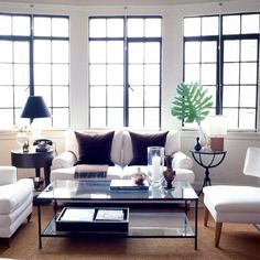 Large iron frame windows with white upholstery