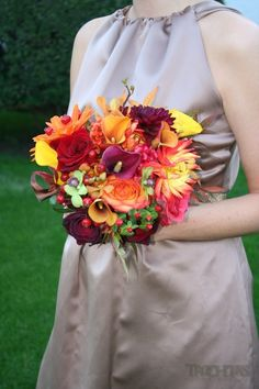 Orange flowers, yellow flowers and red flowers make for a perfect fall wedding bouquet! #trochtas
