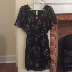 NWT Black floral dress Mid length black dress with floral pattern. Includes built in slip and lace on the back. Never been worn. Xhilaration Dresses Midi