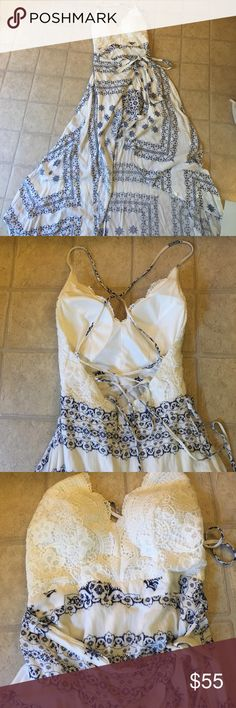 Lace top wrap drew Beautiful wrap dress with tie back, has been worn once size small Dresses High Low