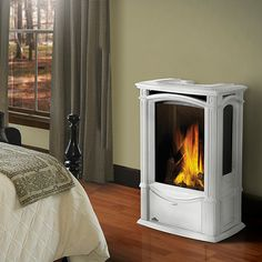 Direct vent gas fireplace with wood stove look in white porcelain.  Tiny, cute - want one!
