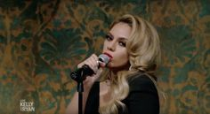 Dinah performing Deliver