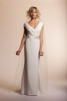 Item #43 An alluring V neckline and unexpected open back exude a stylish confidence that is appropriately glamorous and sophisticated.  A dash of decadence is added with embellished shoulder caps and a splash of beaded embroidery at the side waist for just the right couture.