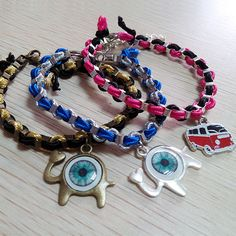 Bracelets made with box chains and Soutache chord and hung with frame pendants and an enamel bus pendant. Simple and fast to make and makes a nice accessory.