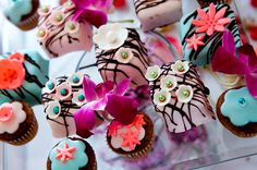 Creative candy buffet...I will definitely have petit fours at my wedding. Also, I love the colors shown here. If I could I would have pale pink, sky blue, bright coral, purple fuchsia, touch of light green, and then the contrasting white and brown all in my wedding, too!
