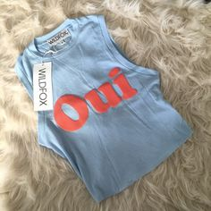 """NWT  WILDFOX Oui Non Ribbed Tank  SOLD OUT // this Wildfox item was made exclusively for Saks // Wildfox Oui Non Ribbed Tank A cropped silhouette with French words stamped on front and back. •Crewneck •Sleeveless •Allover ribbed detail •Pullover style •About 19"""" from shoulder to hem •Rayon/polyester/spandex •Machine wash •Made in USA Wildfox Tops Crop Tops"""