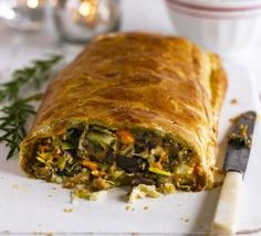 This vegetarian main course is packed with festive flavours like nutmeg and cloves, then wrapped in flaky butter pastry - a real Christmas treat (Vegetarian Christmas Recipes) Vegetarian Xmas, Vegetarian Christmas Dinner, Veggie Christmas, Vegetarian Main Course, Xmas Dinner, Xmas Food, Christmas Cooking, Christmas Christmas, Vegetarian Roast Dinner