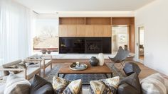 LENNOX STREET - Corben Architects Stunning living room. Genius use of mirror on the right to balance the corner (frameless) window. Lovely example of balance and gorgeous room palette. Really love the wood+white+black+and marble. -Em