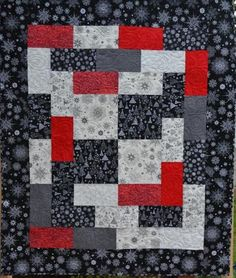 This fun modern winter throw will keep you warm during the holiday season and all winter long,  white snowflakes and trees on black - black snowflakes and trees on white with a little red thrown in for spark. This quilt would also look great as a wall hanging, table topper, or just thrown over a chair or end of bed. measures 47 x 56 100% quality cotton fabric and a low loft cotton batting make this a warm and cozy quilt, I have quilted it in an all over swirl pattern with a light grey…