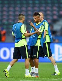 Jordi Alba and Neymar of Barcelona in discussion during an FC Barcelona training session on the eve of the UEFA Champions League Final match against Juventus at Olympiastadion on June 5, 2015 in Berlin, Germany.