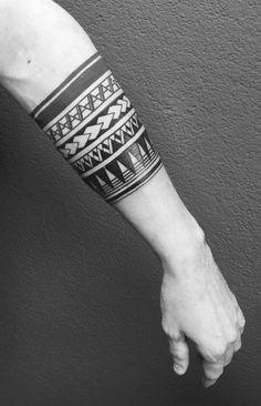 Maori half sleeve tattoo.