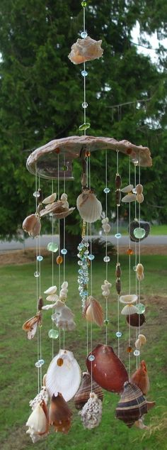 Handmade seashell wind chimes with glass by . Handmade seashell wind chimes with glass by . Seashell Wind Chimes, Diy Wind Chimes, Seashell Art, Seashell Crafts, Beach Crafts, Fun Crafts, Seashell Mobile, Nature Crafts, Seashell Projects