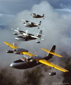 """Flock of Widgeons"" (#2)~ Four Grumman Widgeon amphibian flying boats formate @ sunset over Priest Lake, ID-7/16/93 (Front to back): Merrill Wien's J4F-1 N1340V (s/n-1228), Richard Wien's J4F-2 N90727 (s/n-1334), Gene Riggs' J4F-2 N63350 (s/n-1387) & Steve Hamilton's G-44A N111W (s/n-1420). Shot fm Larry Teufel's G-21A Goose N48550 (s/n-1061). (Copyright '93-Don 'Bucky' Dawson)"