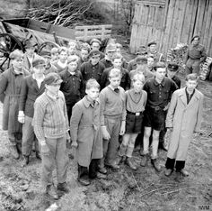 A group of German Hitler Youth who were undergoing training in in Buxtehude in Lower Saxony when British forces entered the town are captured and rounded up (April 1945). They were disarmed and simply sent home to their parents. Image taken by British Sergeant J. Mapham, No. 5 Army Film and Photographic Unit.