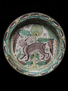 Dish, ca. 1450 (made). Dish of tin-glazed earthenware (maiolica) with an image of a rabbit or hare in front of an artichoke thistle. Italian (Florentine region), about Museum Number Glazes For Pottery, Ceramic Pottery, Pottery Art, Ceramic Art, Antique Pottery, Italian Paintings, Italian Pottery, Rabbit Art, Bunny Art