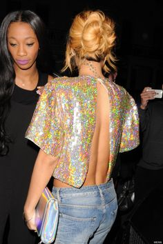 Rihanna narrowly avoids a wardrobe malfunction as she goes bra-less in a sparkling cape top