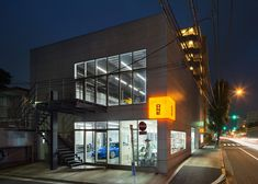 Japanese firm Torafu Architects renovated this auto repair shop in Tokyo to make it look as sleek as a car showroom