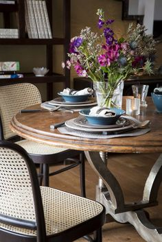 Wooden table with blue-grey tableware. #kitchen #interior #tableware #flower