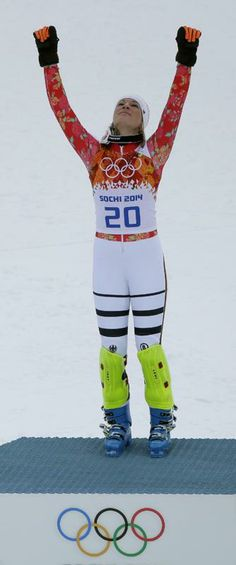 Germany's Maria Hoefl-Riesch celebrates her gold medal in the women's supercombined at the Sochi 2014 Winter Olympics, Monday, Feb. 10, 2014, in Krasnaya Polyana, Russia. (AP Photo/Charlie Riedel)