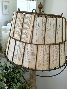 Lamp Shade...old rusty wire basket & book pages...repurposed into a rustic lamp shade...could also weave burlap through the wires for a shabby farmhouse look.