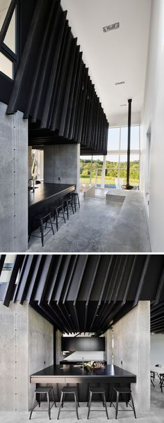 Inside this modern house, which was designed as a weekend escape from the city, the Shou Sugi Ban siding continues and creates a strong contrast to the white walls and polished concrete flooring. In the kitchen, minimalist black cabinets and countertops c