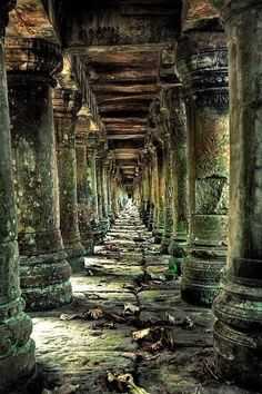Long stone corridor in temple ruins around Siem Reap, Cambodia. Travel photography around SE Asia photography travel Cambodia. Abandoned Mansions, Abandoned Buildings, Abandoned Places, Magic Places, Temple Ruins, Hindu Temple, Ancient Ruins, Belle Photo, Beautiful Places