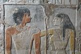 """Pyramid-Age Love Revealed in Vivid Color in Egyptian Tomb.  'Inside a tomb dating back to the age of the Pyramids in Egypt [was] this image, an embrace between a priestess and her husband, a singer in the pharaoh's palace"""""""