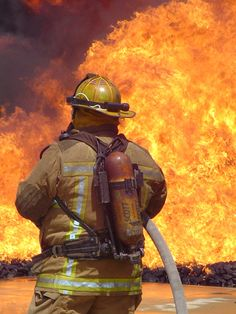 Firefighter battling a large fire. Photo credit: Jim Belford #flames