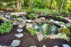 Stunning Koi Pond decorating ideas for Fair Landscape Rustic design ideas with boulders creek ferns fieldstone mulch park bench path pavers rocks rustic steps