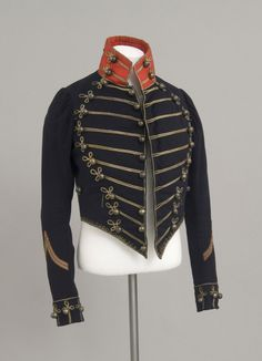 Man's Delaware County Home Guard Uniform: Coat  Artist/maker unknown, American. Worn by Andrew Steel.  Geography: Made in United States, North and Central America Date: c. 1850 Medium: Black fulled wool, metallic braid, metal buttons, silk plain weave Dimensions: Waist: 30 inches (76.2 cm) Center Back Length: 24 inches (61 cm) Accession Number: 1949-65-3a--c